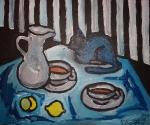 Zátiší s čajem a černou kočkou